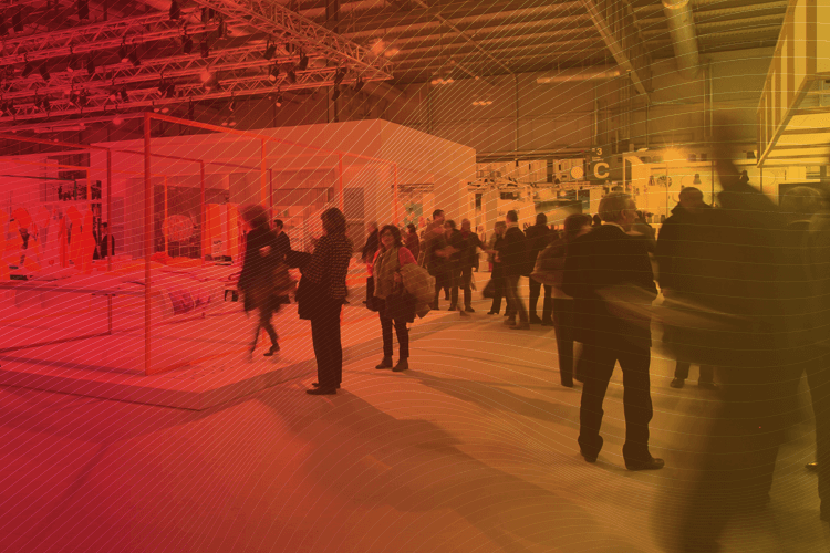 event featured image that shows a trade show with professional people walking around